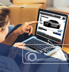 a man and woman looking at a car dealer site on a laptop