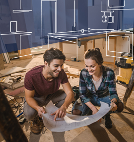 a man and a woman sitting in an empty kitchen, looking at a blueprint and visualizing a new kitchen