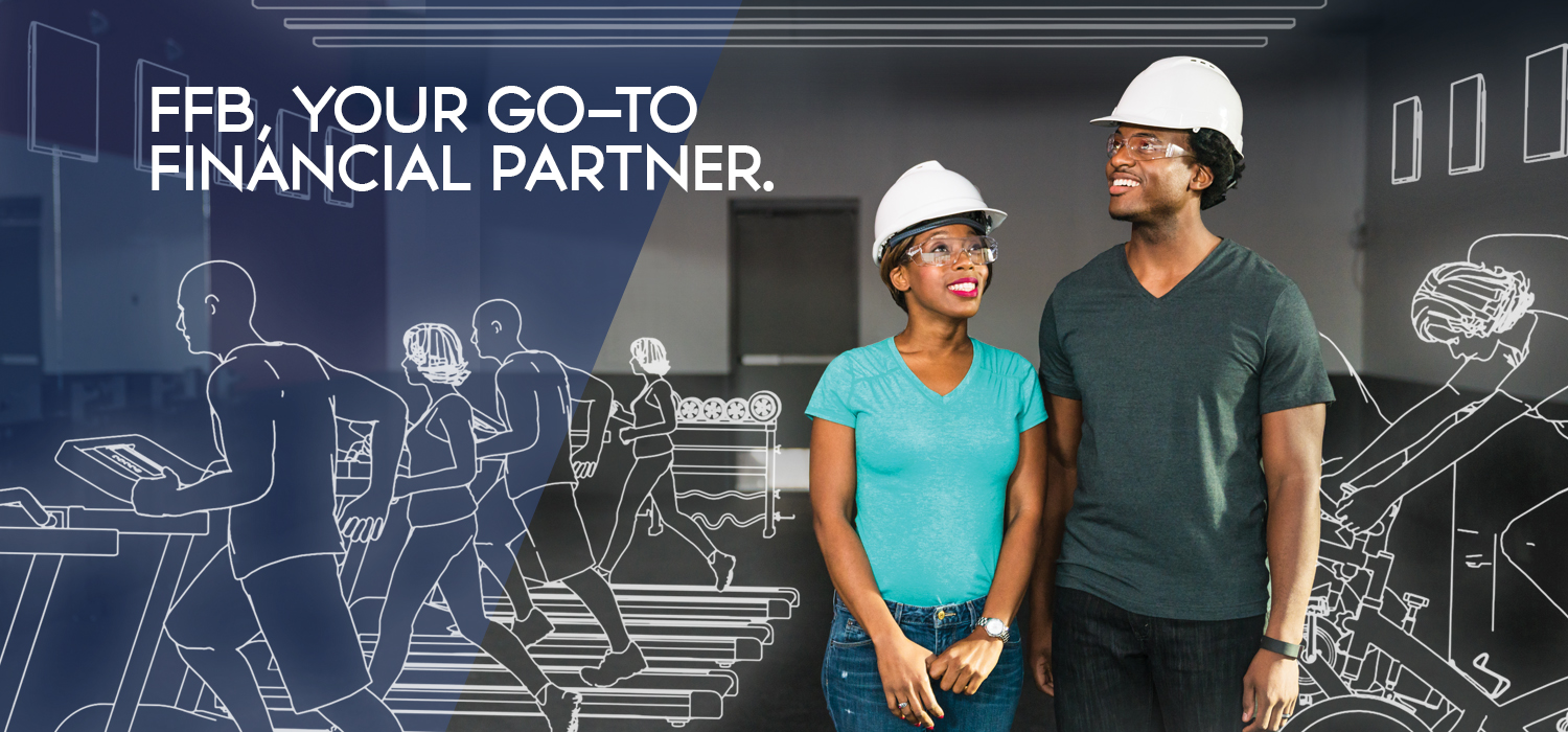 a man and a woman wearing hard hats looking at an empty room and visualizing a workout facility